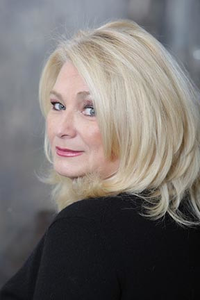 Headshot for author Marian Lanouette.